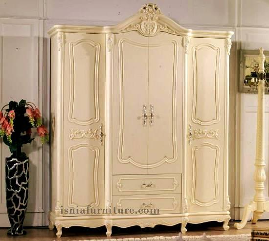 lemari pakaian 4 pintu ukiran minimalis